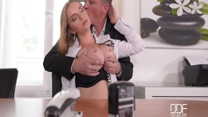 Very tasty and busty Steve Holmes bends over in office