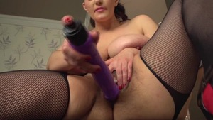 Busty housewife takes large vibrator