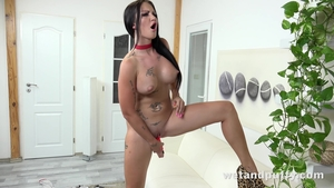 Inked female Isabel Dark playing with toys