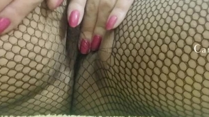 Tight female wearing fishnets teasing