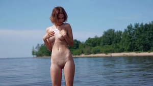 Teasing together with naked babe in bodysuit outdoors