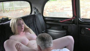 Big ass blonde sucking cock in a taxi